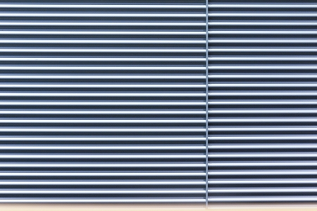 homogeneous: homogeneous pattern of closed metallic roll curtain Stock Photo
