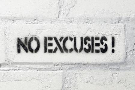 no excuses exclamation stencil print on the white brick wall Archivio Fotografico