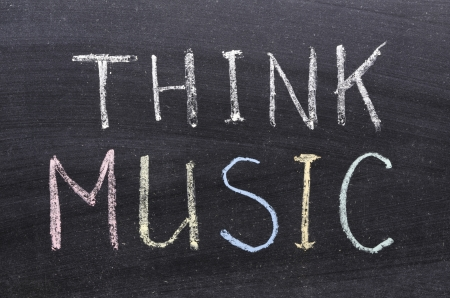 think music phrase handwritten on the school blackboard photo