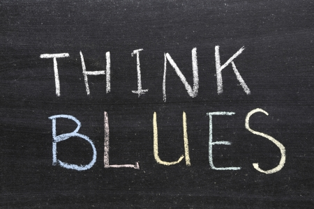 think blues phrase handwritten on the school blackboard photo