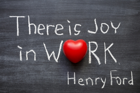 henry: excerpt from famous Henry Ford quote There is joy in work. There is no happiness except in the realization that we have accomplished something. handwritten on blackboard Stock Photo