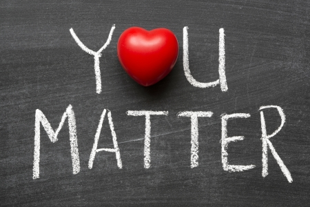 matters: you matter phrase handwritten on school blackboard