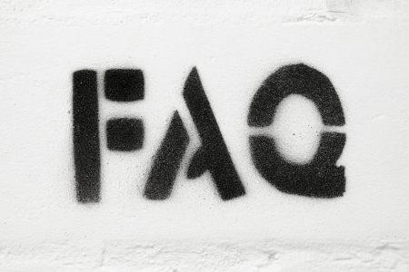 frequently asked question: stencil print of abbreviation FAQ  on the white brick wall