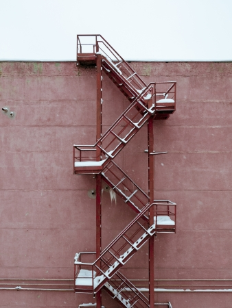 metallic stairs: metallic industrial stairs covered by snow Stock Photo