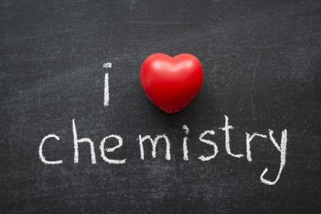 phrase novel: I love chemistry phrase handwritten on the school blackboard Stock Photo