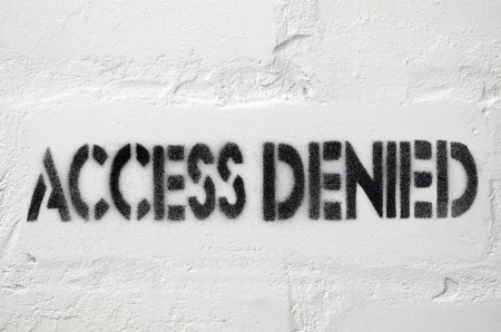 access denied black stencil print on the white brick wall
