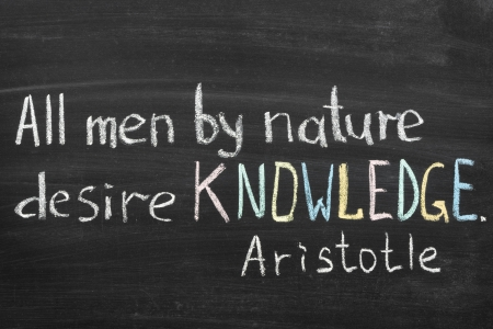 desire: famous Aristotle quote  All men by nature desire knowledge  handwritten on blackboard Stock Photo