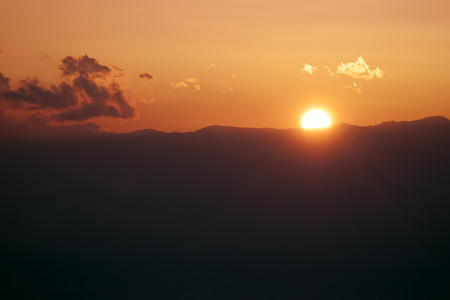 sunset scenery from Japanese mountains with small cloud on the red sky