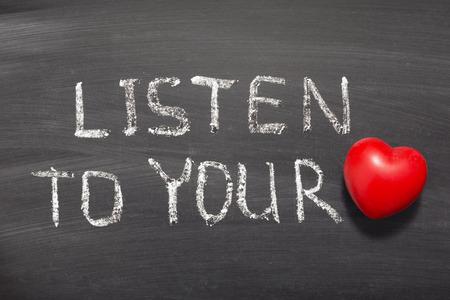 listen to your heart chalk drawing on blackboard Stock Photo