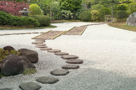 Japanese zen garden with scenic stone pathway  Stock Photo