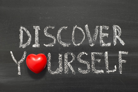 discover yourself phrase handwritten on school blackboard