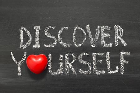phrase: discover yourself phrase handwritten on school blackboard
