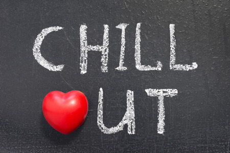chillout word handwritten on chalkboard with heart symbol instead of O photo