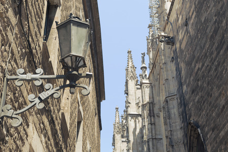 famous Gothic Quarter in Barcelona with focus on foreground street lamp photo