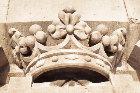 Spanish crown relief from famous Columbus monument in Barcelona, Spain photo