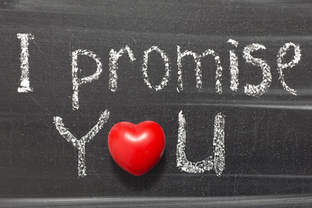 I promise you phrase handwritten on chalkboard with heart symbol instead of O
