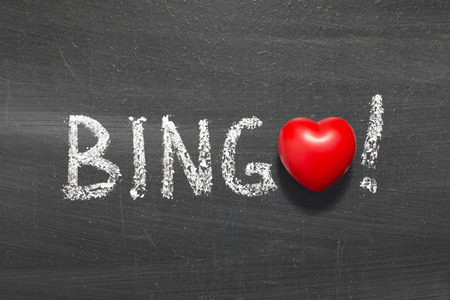 bingo word handwritten on chalkboard with heart symbol instead of O Stock Photo