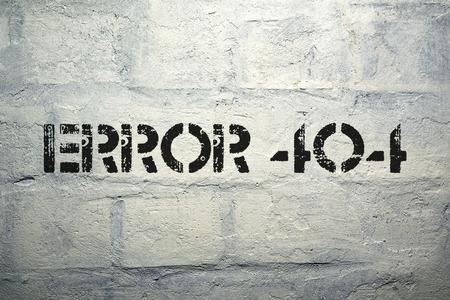 error 404 stencil print on the grunge white brick wall photo