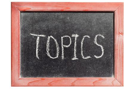 topics: TOPICS word handwritten on isolated vintage blackboard