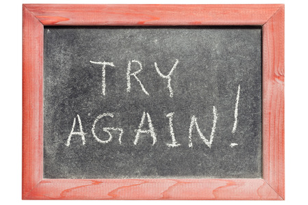 again: try again exclamation handwritten on isolated vintage blackboard Stock Photo