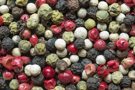different types of peppercorns closeup shot photo