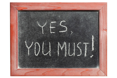 yes you must exclamation handwritten on isolated vintage blackboard