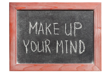 make up your mind phrase handwritten on isolated vintage blackboard photo