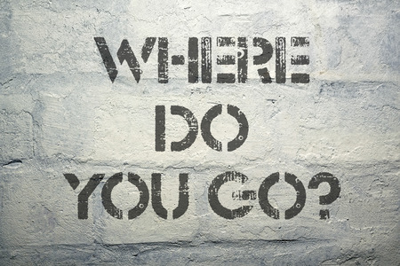 where to go: where do you go question stencil print on the grunge brick wall  Stock Photo