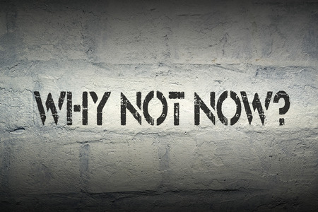 why not now question stencil print on the grunge brick wall photo