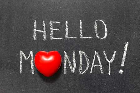 hello Monday exclamation handwritten on chalkboard with heart symbol instead of O Banco de Imagens