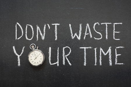 dont waste your time phrase handwritten on chalkboard vintage precise stopwatch used instead of O  Stock Photo