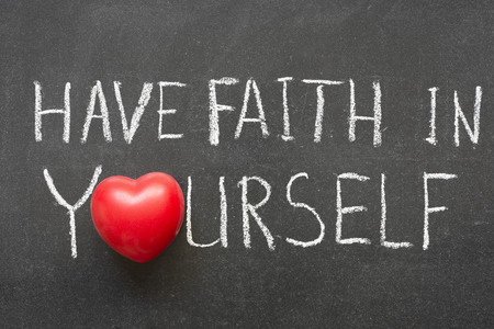 have faith in yourself phrase handwritten on chalkboard with heart symbol instead of O photo