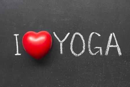 I love yoga phrase handwritten on chalkboard with heart symbol  photo