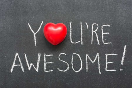 you are awesome exclamation handwritten on chalkboard with heart symbol instead of O