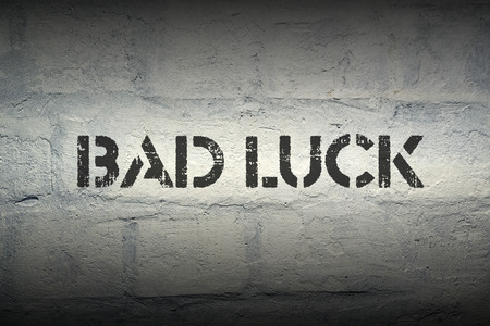 bad luck: bad luck stencil print on the grunge brick wall with gradient effect Stock Photo