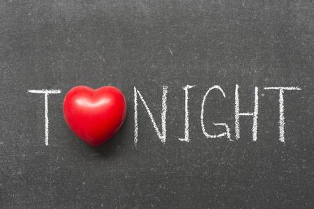 tonight: tonight word handwritten on school blackboard with heart symbol instead of O