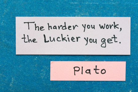 famous ancient Greek philosopher Plato quote interpretation with sticky notes on vintage carton board about hard work