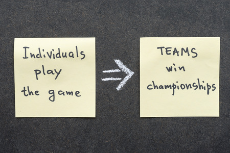interpretation: famous proverb interpretation with sticky notes on blackboard about teamwork