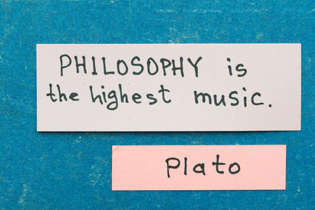 philosophy of music: famous ancient Greek philosopher Plato quote interpretation with sticky notes on vintage carton board about philosophy