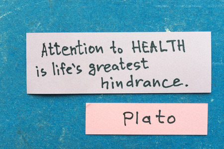 interpretation: famous ancient Greek philosopher Plato quote interpretation with sticky notes on vintage carton board about health