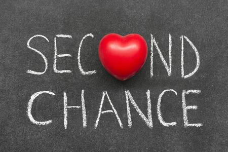 phrase: second chance phrase handwritten on blackboard with heart symbol  Stock Photo