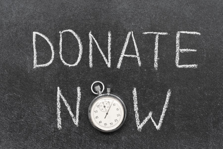 precise: donate now concept handwritten on chalkboard with vintage precise stopwatch used
