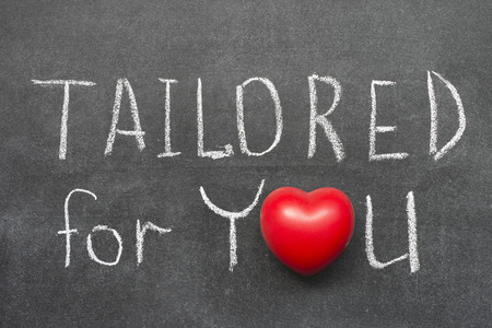tailored: tailored for you phrase handwritten on blackboard with heart symbol instead of O