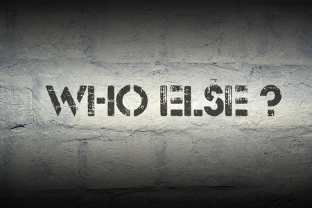 else: who else stencil print on the grunge white brick wall