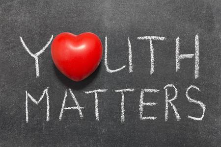 matters: youth matters phrase handwritten on blackboard with heart symbol instead of O