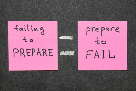 failing: interpretation of famous quote of B. Franklin By failing to prepare, you are preparing to fail. handwritten on pink paper