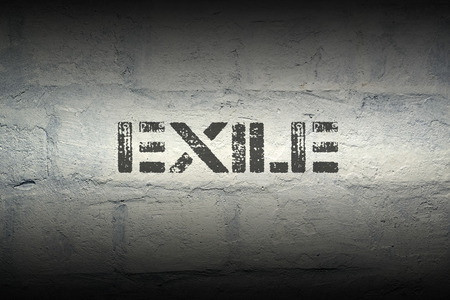 exile: exile stencil print on the grunge white brick wall