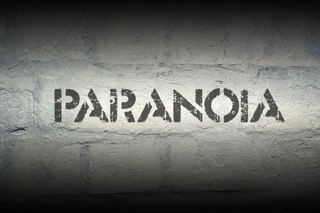 paranoia: paranoia stencil print on the grunge white brick wall