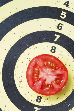 ten best: darts target with fresh red tomato slice in center