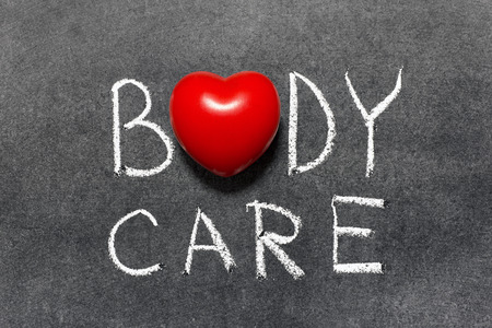 body care phrase handwritten on blackboard with heart symbol instead of O